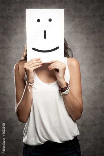 woman holding smile symbol