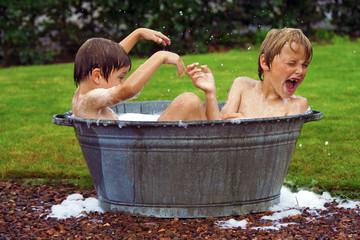 kids in zinc bathtub