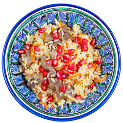 top view on traditional asian pilaf with pomegranate