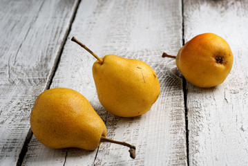 Yellow pears on a wooden table