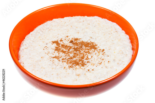 oat porridge with cinnamon in orange bow