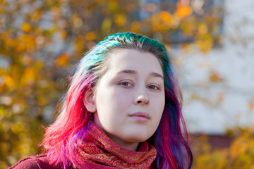 young woman with multicoloured streaks hair