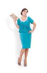 Beautiful woman in blue dress standing next to white background