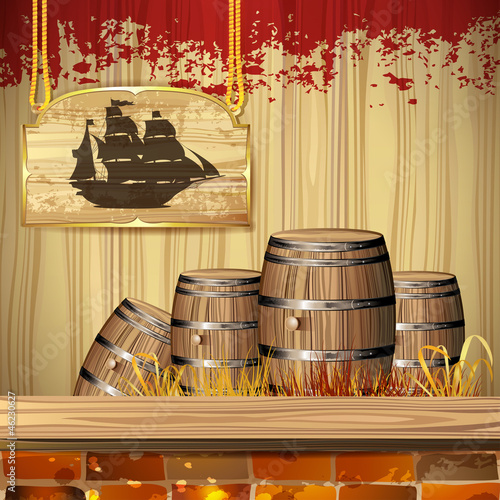 Pirate ship over wood banner and barrels