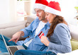 Couple with credit card buying online. Christmas Shopping