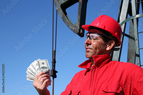 Oil Worker With Dirty Face Holding US Dollar Bills