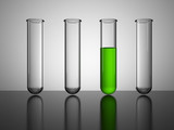 Glass beakers.Test tube with green liquid