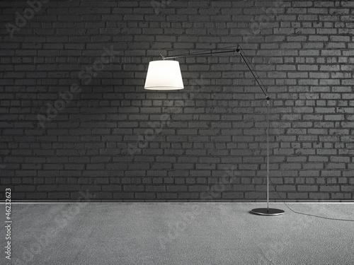 Lamp front of a brick wall