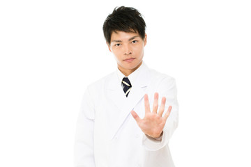 Asian young medical doctor isolated on white background