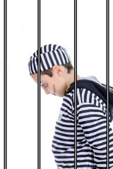 A view of a sad prisoner in jail