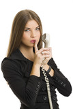Successful businesswoman gesturing keep silence