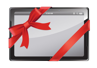 Tablet PC with red ribbon and bow isolated