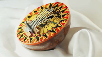 Musical Instrument kalimba rotates on a white background