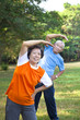 Happy asian senior fitness couple in the park