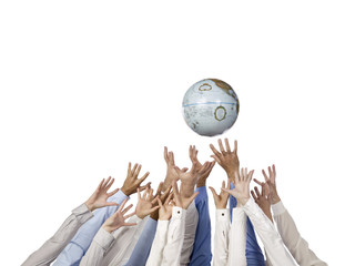 diverse group of hands reaching a globe
