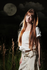 Beautiful woman under full moon
