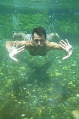man underwater in the pool