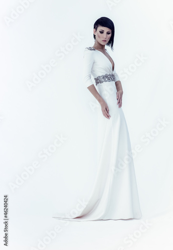 fashion portrait of a sensual girl in a white dress