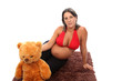 beautiful pregnant woman with beautiful belly and teddy bear