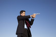 Businessman aiming a handgun