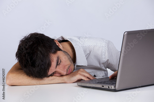 Exhausted man sleeping at his office