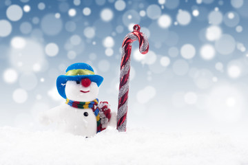 Snowman doll with candy cane