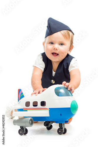 baby girl dressed as  stewardess with airplane toy
