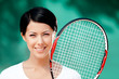 Portrait of young female tennis player with racquet