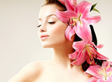 beautiful girl with pink lilies in her hair - 46243263