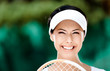 Close up of happy woman with tennis racket
