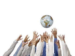 group of hands reaching the world globe