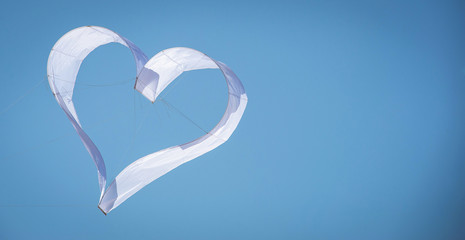 Heart kite in the blue sky with copy space.