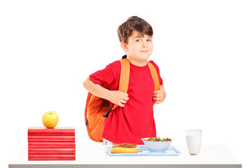 A schoolboy preparing for lunch