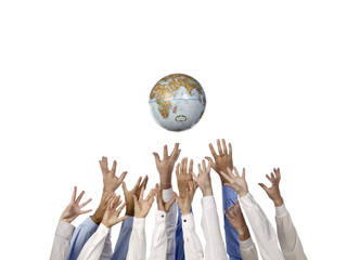 many hands reaching up on the globe