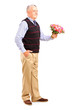 Full length portrait of a gentleman holding a bunch of flowers