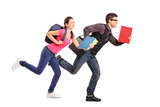 Students rushing forwards with books in their hands