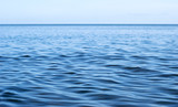 Blue sea surface with easy ripples