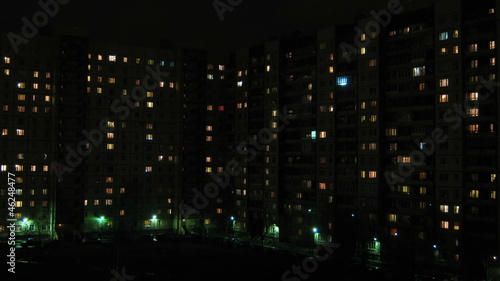 windows in houses are lit at night and go out - timelapse