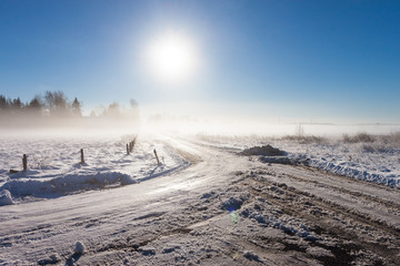 winter landscape at fog  with road