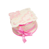 White and pink cake with ribbon and decorations from the mastic poster