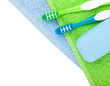 Toothbrushes and soap over towels