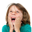 Kid laughing with hands on face.