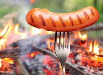 Sausage on a fork.