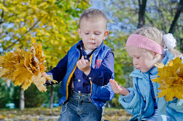 Boy and Girl in Autumn Setting