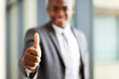 modern african american business executive thumb up