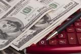 Money, pen and calculator