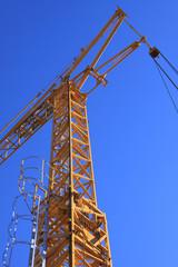yellow crane with blue sky