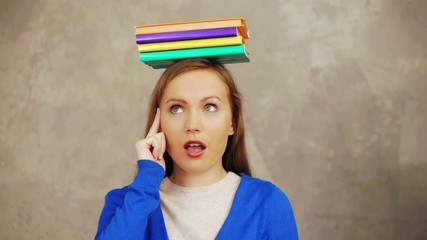 Knowledge from books: student books on her head