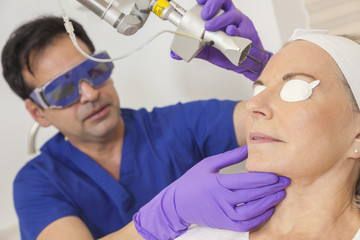 Doctor Fractional CO2 Laser Skin Treatment Senior Woman
