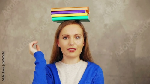 Pretty student books on her head